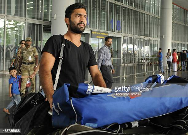Indian cricketer who plays for RCB Dinesh Karthik arrives at NSCBIA Dum Dum Airport on April 6 2015 in Kolkata India Bollywood actors Hrithik Roshan...