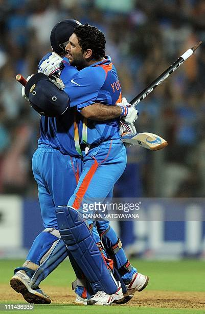 Indian cricketer Yuvraj Singh and captain Mahendra Singh Dhoni celebrate after beating Sri Lanka during the ICC Cricket World Cup 2011 final match at...