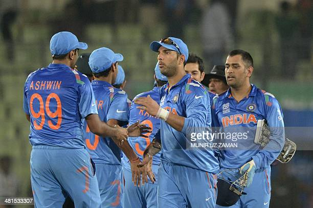 Indian cricketer Yuvraj Singh and captain Mahendra Singh Dhoni shake hands after winning the ICC World Twenty20 tournament cricket match between...