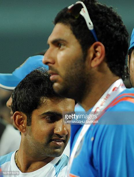 Indian cricketer Yuvraj Singh and Gautam Gambhir look during the prize distribution ceremony after the final One Day International match between...
