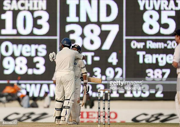 Indian cricketer Yuvraj Singh celebrates with teammate Sachin Tendulkar for his century and India's win on the fifth and final day of the first Test...