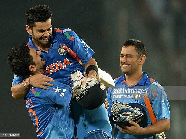 Indian cricketer Yuvraj Singh picks up batsman Virat Kohli as captain Mahendra Singh Dhoni watches after India won the ICC World Twenty20 cricket...