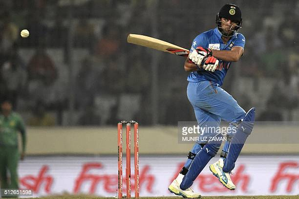 Indian cricketer Yuvraj Singh plays a shot during the match between India and Pakistan at the Asia Cup T20 cricket tournament at the ShereBangla...