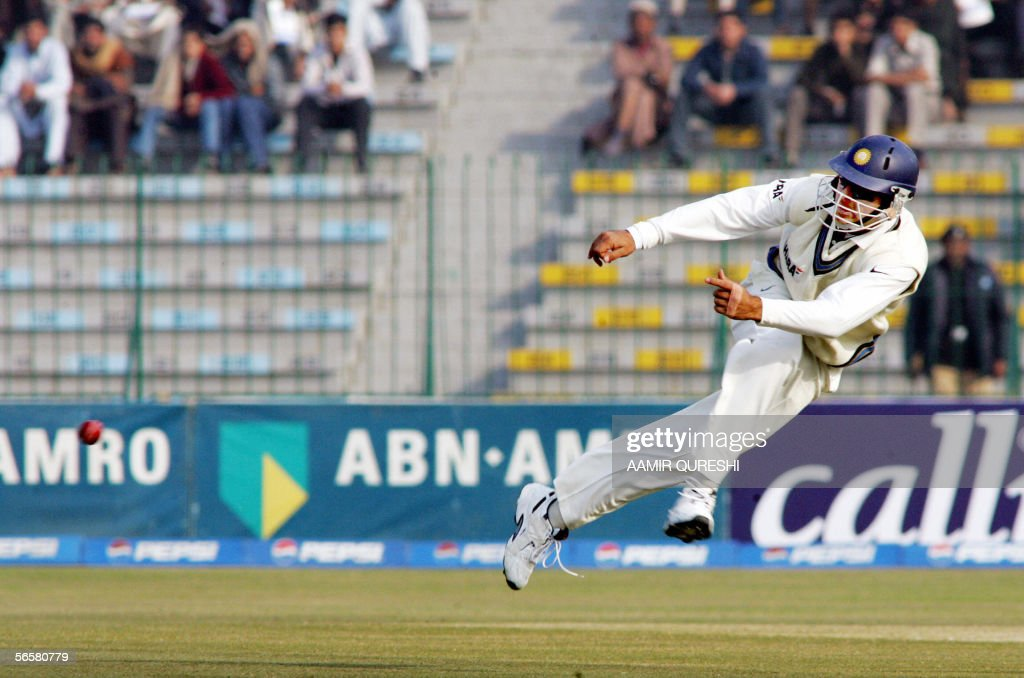 Indian cricketer Yuvraj Singh throws the ball as he successfully runout by Pakistani batsman Salman Butt for 6 runs during the first day of the first...