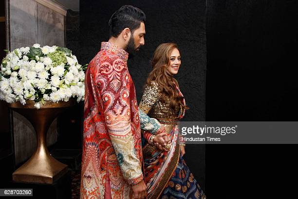 Indian Cricketer Yuvraj Singh with Bollywood actor Hazel Keech during their wedding reception at ITC Maurya on December 7 2016 in New Delhi India