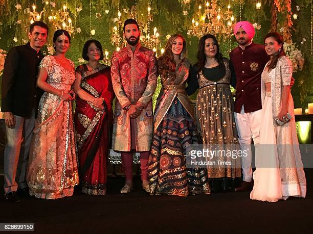 Indian Cricketer Yuvraj Singh with his wife and Bollywood actor Hazel Keech and Cricketer Harbhajan Singh with his wife and actor Geeta Basra during...