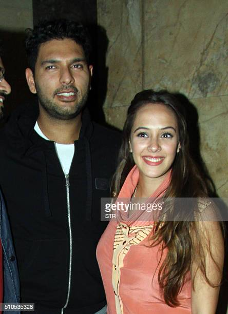 Indian cricketer Yuvraj Singh with his wife modelactress Hazel Keech attends a screening of Hindi film 'Neerja' in Mumbai on February 15 2016 AFP...