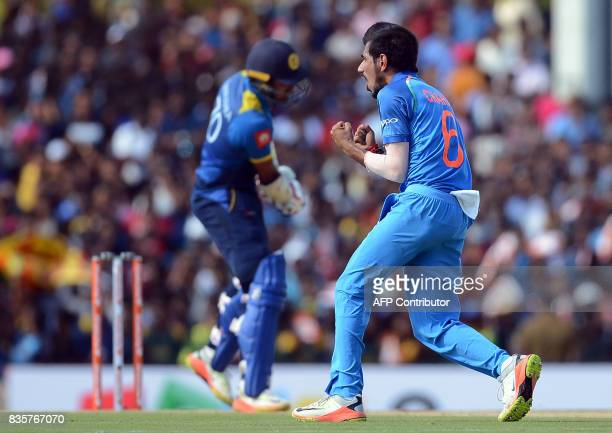 Indian cricketer Yuzvendra Chahal celebrates after he dismissed Sri Lankan cricketer Dhanushka Gunathilaka during the first One Day International...