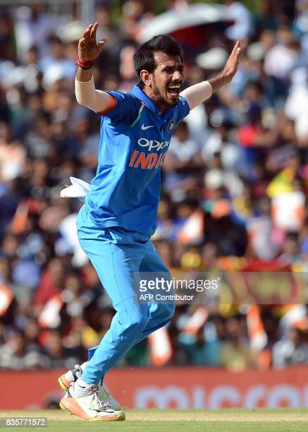 Indian cricketer Yuzvendra Chahal unsuccessfully appeals for a Leg Before Wicket decision against Sri Lankan cricketer Niroshan Dickwella during the...