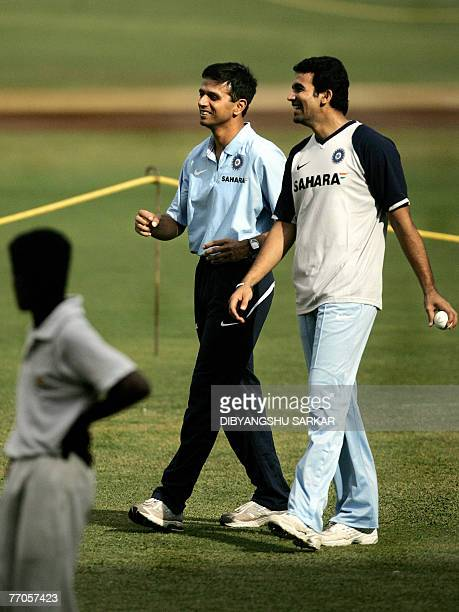 Indian cricketer Zaheer Khan enjoys a light moment with former captain Rahul Dravid during a training session at the Chinnaswamy Stadium in Bangalore...
