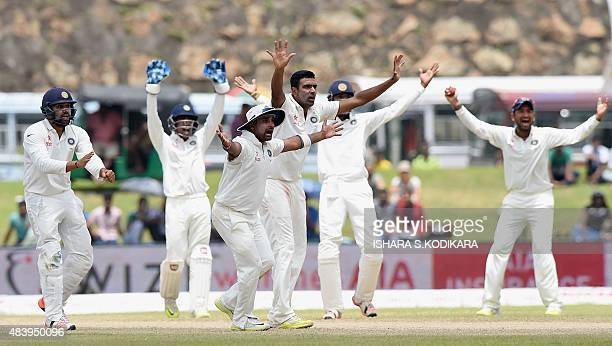 Indian cricketers Amit Mishra Ravichandran Ashwin and teammates successfully appeal for a decision against unseen Sri Lankan batsman Lahiru...