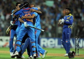 Indian cricketers celebrate after beating Sri Lanka during the ICC Cricket World Cup 2011 final match at The Wankhede Stadium in Mumbai on April 2...