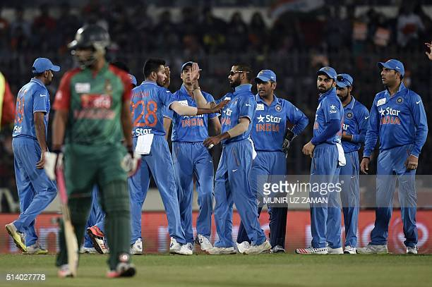 Indian cricketers celebrate after the dismissal of the Bangladesh cricketer Tamim Iqbal during the Asia Cup T20 cricket tournament final match...
