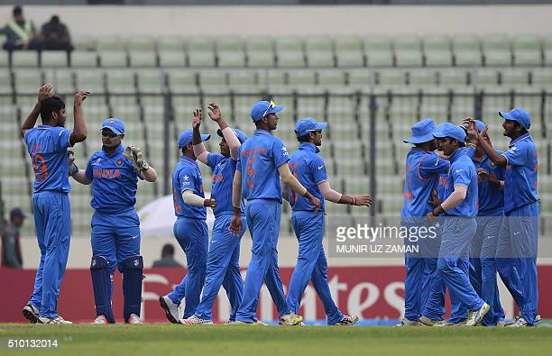 Indian cricketers celebrate after the dismissal of the West Indies cricketer Gidron Pope during the under19s World Cup cricket final between India...