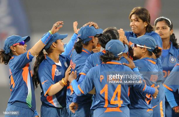 Indian cricketers celebrate the run out of Kycia Knight of West Indies during the inaugural match of the ICC Women's World Cup 2013 between India and...