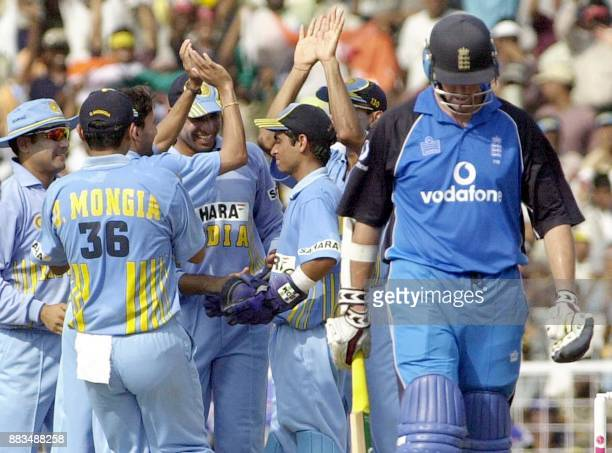 Indian cricketers celebrate the wicket of England's Marcus Trescothik during their third oneday match against England at the MA Chidambaram stadium...
