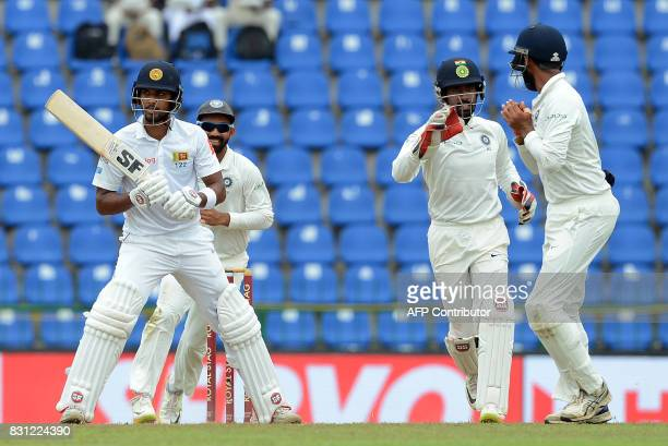 Indian cricketers celebrates after dismissing Sri Lankan cricket captain Dinesh Chandimal during the third day of the third and final Test match...