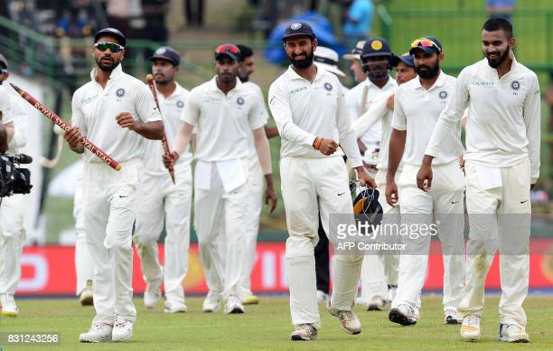 Indian cricketers celebrates after their victory in the third and final Test match between Sri Lanka and India at the Pallekele International Cricket...