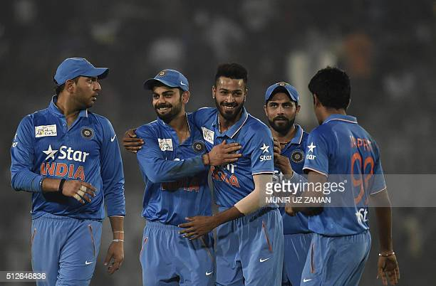 Indian cricketers congratulate teammate Hardik Pandya after the dismissal of the Pakistan cricketer Mohammad Amir during the match between India and...