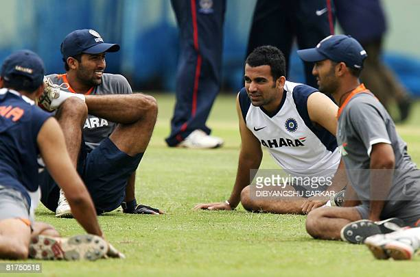 Indian cricketers Dinesh Karthik Zaheer Khan Wasim Jaffar and Anil Kumble stretch during a training camp at the Chinnaswamy Stadium in Bangalore on...