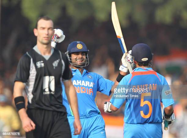 Indian cricketers Gautam Gambhir and Virat Kohli celebrates the victory during the third One Day International match between India and New Zealand at...