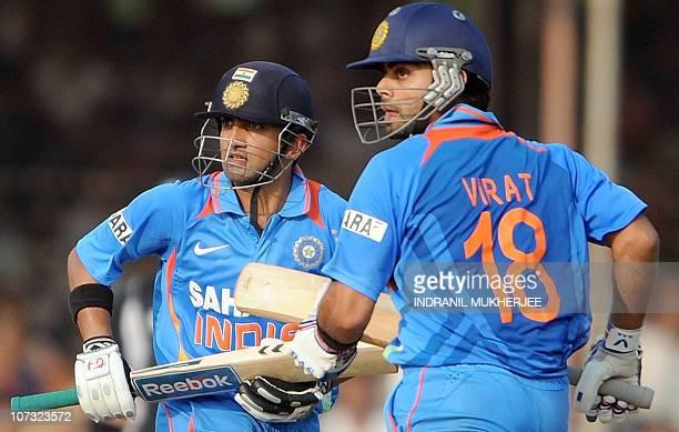 Indian cricketers Gautam Gambhir and Virat Kohli take a run during the third One Day International match between India and New Zealand at the...