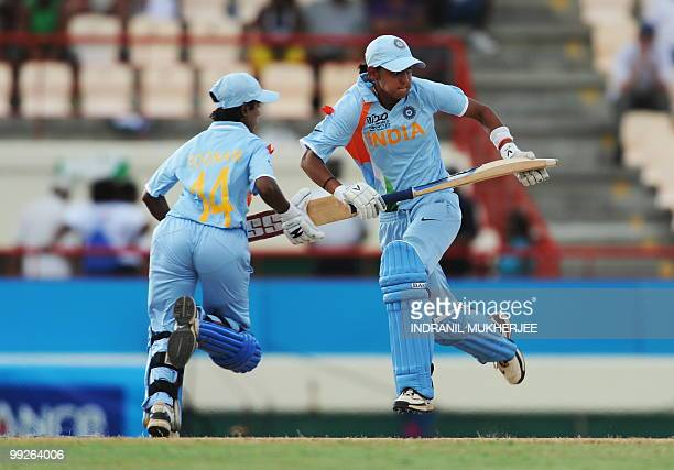 Indian cricketers Harmanpreet Kaur and Poonam Raul take a run during the ICC Women�s World Cup Twenty20 semi final match between Australia and India...
