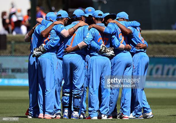 Indian cricketers have a team huddle prior to the Pool B Cricket World Cup match between India and Ireland at Sedden Park in Hamilton on March 10...