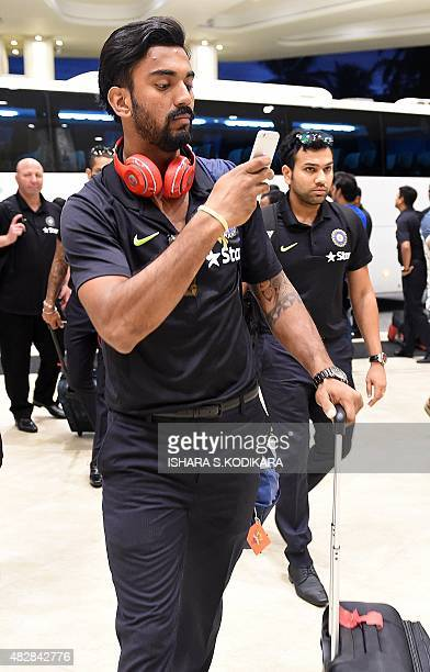 Indian cricketers Lokesh Rahul and Rohit Sharma arrive at a hotel in Colombo on August 3 2015India will play three Test series matches in Sri Lanka...