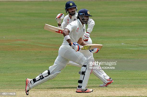 Indian cricketers Lokesh Rahul and Shikhar Dhawan run between the wickets during the first day of the threeday warmup cricket match between Sri Lanka...