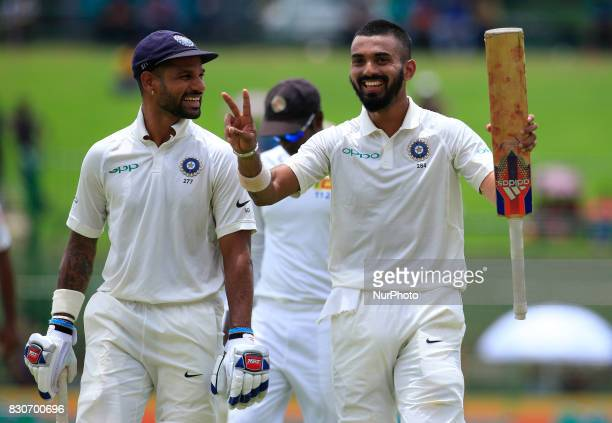 Indian cricketers Lokesh Rahul and Shikhar Dhawan walk back to the pavilion after the end of the 1st session at the 1st Day's play in the 3rd Test...