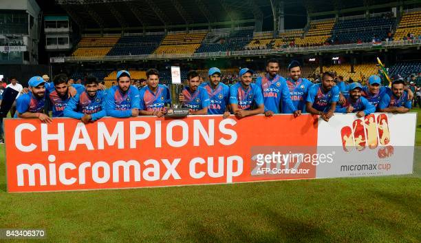 Indian cricketers pose for photographers after their victory in the Twenty20 international cricket match between Sri Lanka and India at R Premadasa...