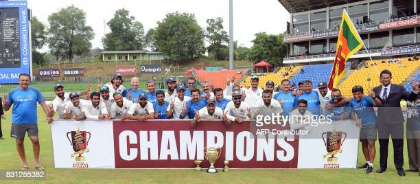 Indian cricketers pose for photographers after victory in the third day of the third and final Test match between Sri Lanka and India at the...