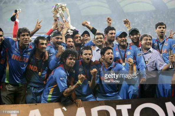Indian cricketers pose with the trophy after victory in the Cricket World Cup 2011 final over Sri Lanka at The Wankhede Stadium in Mumbai on April 2...