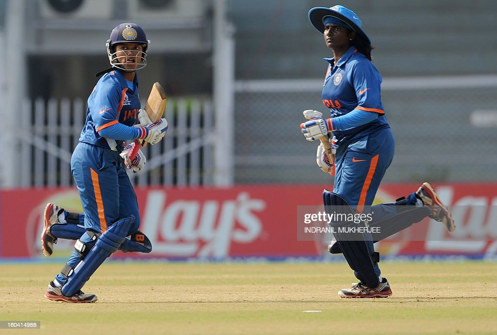 Indian cricketers Punam Raut (L) and Thirush Kamini (R) take a run during the inugural match of the ICC Women's World Cup 2013 between India and West Indies at the Cricket Club of India's Brabourne stadium in Mumbai on January 31, 2013. Teams from Australia, England, New Zealand, Pakistan, South Africa, Sri Lanka, West Indies join hosts India for the global event which is being played from 31 January to 17 February. The women's World Cup opened in Mumbai with the cricketers hoping to put aside memories of the unsavoury build-up and gain their due recognition in a country where the men's game reigns supreme. AFP PHOTO/ Indranil MUKHERJEE