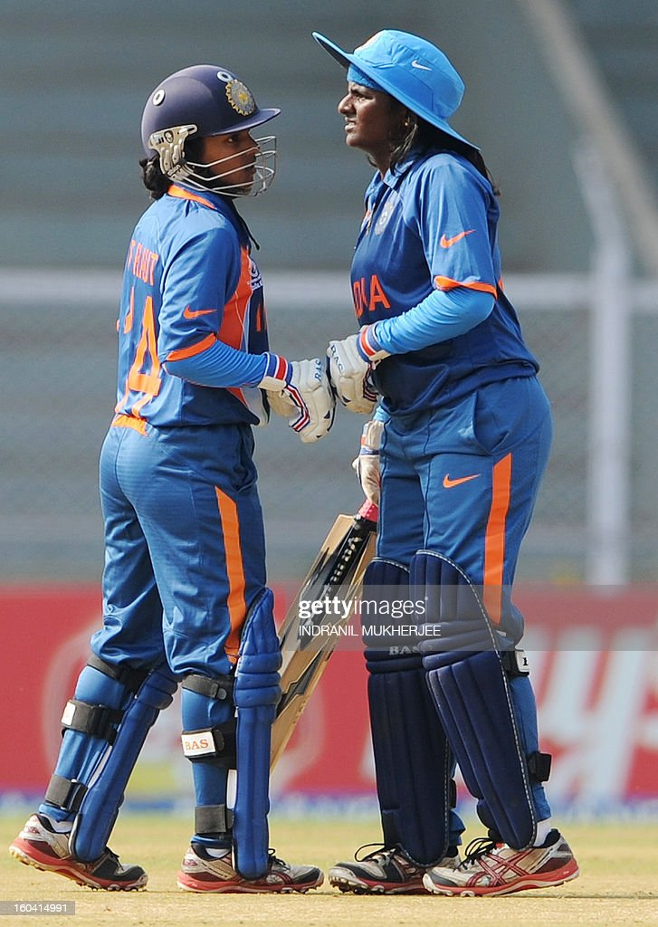 Indian cricketers Punam Raut (L) and Thirush Kamini (R) touch fists during the inugural match of the ICC Women's World Cup 2013 between India and West Indies at the Cricket Club of India's Brabourne stadium in Mumbai on January 31, 2013. Teams from Australia, England, New Zealand, Pakistan, South Africa, Sri Lanka, West Indies join hosts India for the global event which is being played from 31 January to 17 February. The women's World Cup opened in Mumbai with the cricketers hoping to put aside memories of the unsavoury build-up and gain their due recognition in a country where the men's game reigns supreme. AFP PHOTO/ Indranil MUKHERJEE