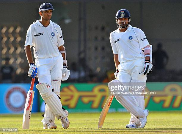 Indian cricketers Rahul Dravid and Sachin Tendulkar look on as they wait for a decision from the third umpire for the wicket of Tendulkar during the...