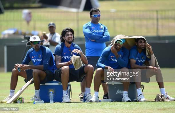 Indian cricketers Ravichandran Ashwin Ishant Sharma Umesh Yadav and Bhuvneshwar Kumar rest during a practice session at the Sinhalease Sports Club...