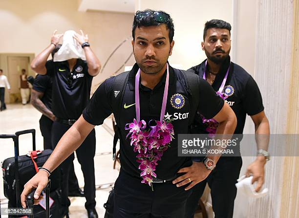 Indian cricketers Rohit Sharma and Murali Vijay arrive at a hotel in Colombo on August 3 2015 India will play three Test series matches in Sri Lanka...