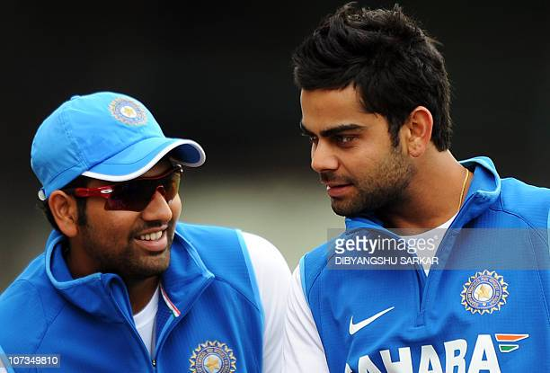 Indian cricketers Rohit Sharma and Virat Kohli look on during a training session ahead of the fourth One Day International match between India and...