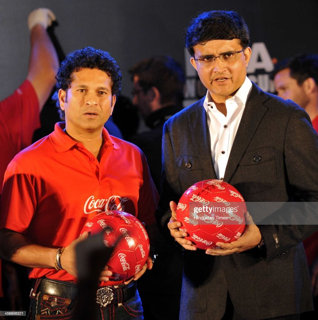 Indian cricketers Sachin Tendulkar and Saurav Ganguly during a unveils of FIFA World cup Trophy by Carlos Alberto Torres, former Brazilian World Cup captain on December 22, 2013 in kolkata, India. Tendulkar said he was honoured to be present as the FIFA World Cup trophy was unveiled in Kolkata. 'It's a special moment. I hope all the people from Kolkata will enjoy the trophy and respect the rules and regulations.'