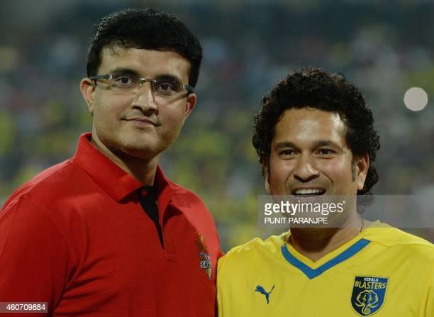 Indian cricketers Sachin Tendulkar and Saurav Ganguly pose before the start of the Indian Super League final football match between Kerala Blasters...