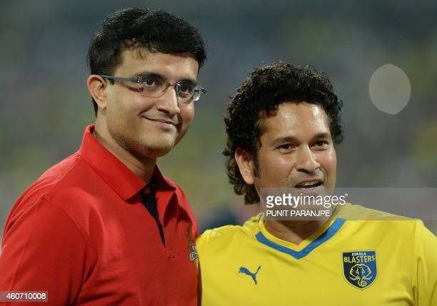 Indian cricketers Sachin Tendulkar and Sourav Ganguly pose before the start of the Indian Super League final football match between Kerala Blasters...