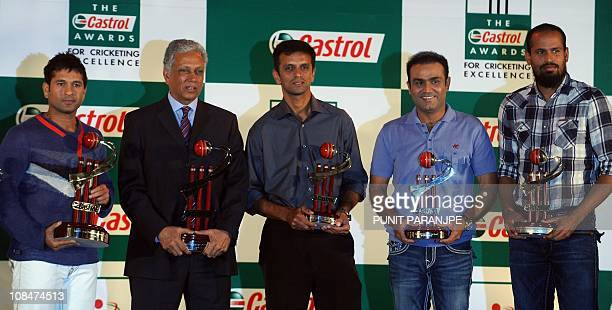 Indian cricketers Sachin Tendulkar former cricketer Mohinder Amarnath Rahul Dravid Virender Sehwag and Yusuf Pathan pose for photographers during the...