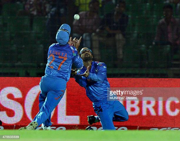 Indian cricketers Shikhar Dhawan and Ajinkya Rahane attempt to make a catch during the fourth match of the Asia Cup oneday cricket tournament between...
