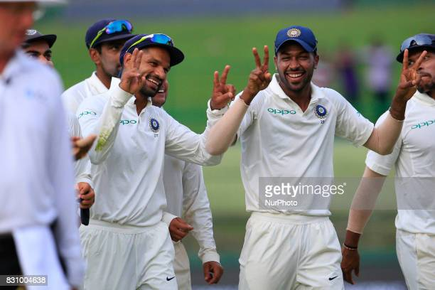 Indian cricketers Shikhar Dhawan and Hardik Pandya walk back to the pavilion after the play ended during the 2nd Day's play in the 3rd Test match...