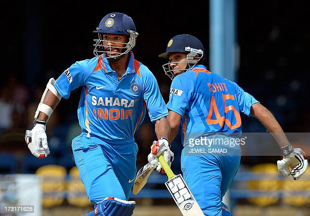 Indian cricketers Shikhar Dhawan and Rohit Sharma take a single during the sixth match of the TriNation series between India and Sri Lanka at the...