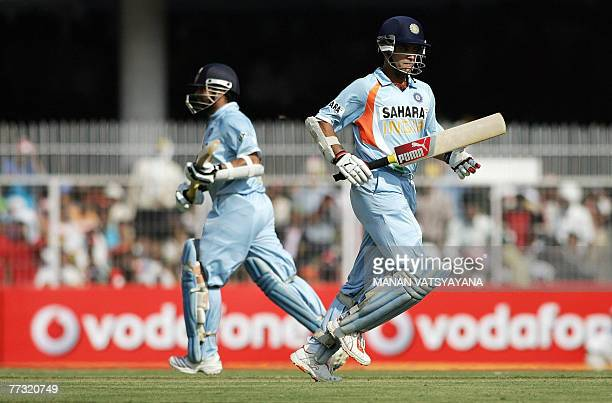 Indian cricketers Sourav Ganguly and Sachin Tendulkar run between the wickets during the sixth Oneday International match between India and Australia...