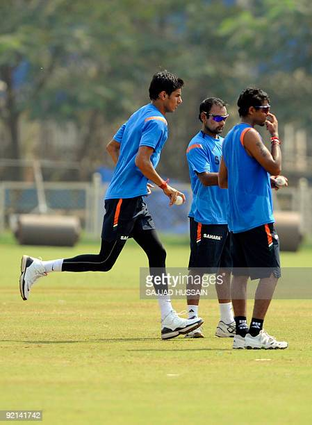 Indian cricketers Sudeep Tyagi Amit Mishra and Ravindra Jadeja take part in a threeday preparatory camp in Mumbai on October 21 2009 Australia will...