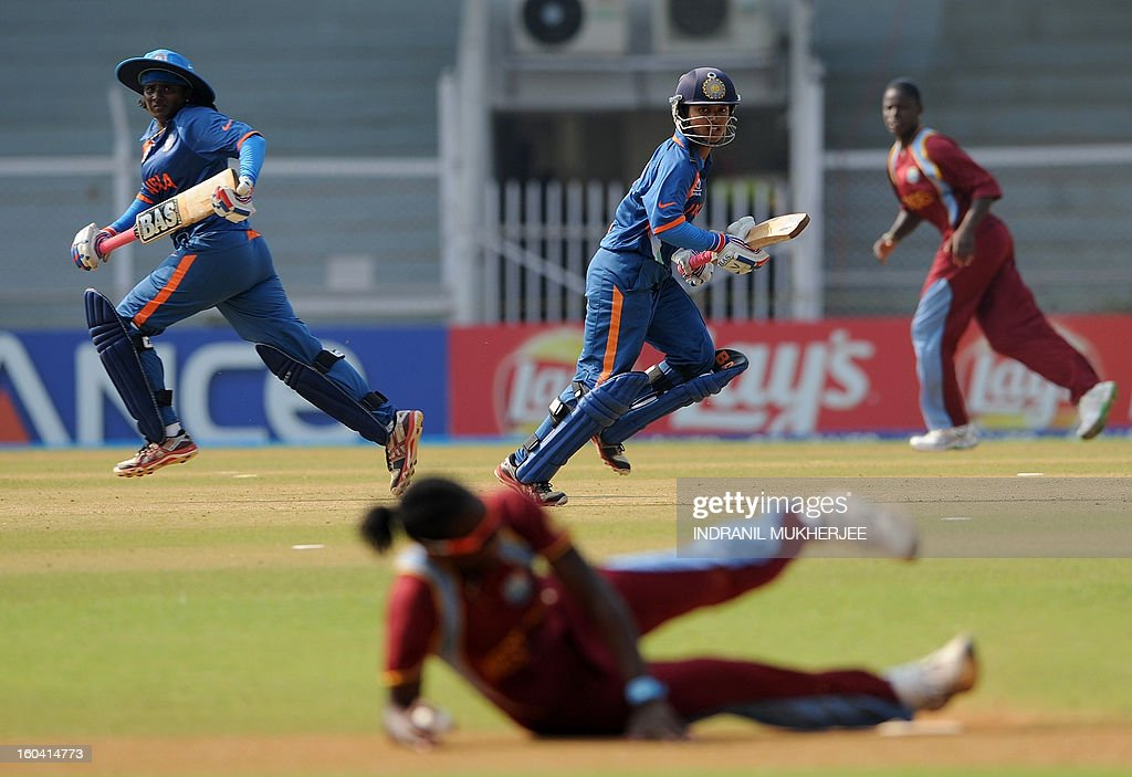 Indian cricketers Thirush Kamini (L) and Punam Raut (C) take a run during the inaugural match of the ICC Women's World Cup 2013 between India and West Indies at the Cricket Club of India's Brabourne stadium in Mumbai on January 31, 2013. Teams from Australia, England, New Zealand, Pakistan, South Africa, Sri Lanka, West Indies join hosts India for the global event which is being played from 31 January to 17 February. The women's World Cup opened in Mumbai with the cricketers hoping to put aside memories of the unsavoury build-up and gain their due recognition in a country where the men's game reigns supreme. AFP PHOTO/ Indranil MUKHERJEE